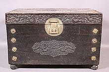 CHINESE CARVED TRUNK W/BRASS FITTINGS