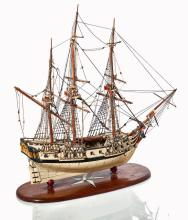 Ø A WOOD AND IVORY PRISONER-OF-WAR-STYLE MODEL OF A WARSHIP, LATE 19TH-CENTURY