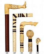 Ø A 19TH-CENTURY WHALEBONE AND MARINE IVORY WALKING STICK