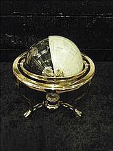 Semi-precious gemstone globe on brass stand