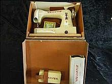 Cased Helvetia portable sewing machine
