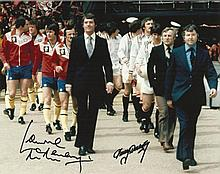 Laurie McMenemy and Tommy Doherty signed colour photo of them leading their