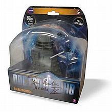 Tom Baker Dr Who actor signed to case of Dalek