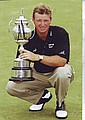Ernie Els signed 12 x 8 colour photo showing the South African Golf start holding another winners trophy