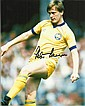 Peter Barnes signed 10 x 8 colour Leeds Utd football photo. He is one of a small number of players to have played for both Manchester City and Manchester United.