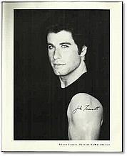 """B/W 10""""x 8"""" signed photo of John Travolta, in black shirt from Grease era. Scarce autograph Good condition"""