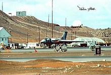 Falklands War: 8x12 inch photo of Vulcan bomber at Ascension Island in 1982 being prepared for its mission to bomb the airfield at Port Stanley, signed by RAF Vulcan bomber pilot Martin Withers DFC who was a Flight Lieutenant at the time of Black