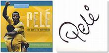 """Large boxed book entitled """"Pele My Life In Pictures"""", large autograph by the legendary Pele himself. Great Condition Good condition"""