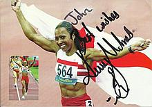 Kelly Holmes signed colour photo with her athletics career highlights on re