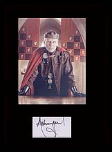 Merlin. Signature of Anthony Head with a picture in character as