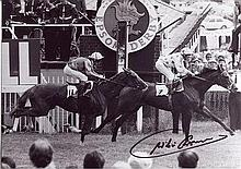 WILLIE CARSON: 7x10 inch photosigned by Willie Carson, pictured winning the