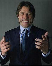 John Bishop, A 25cm x 20cm , 10 x 8 inches photo signed by John Bishop in b