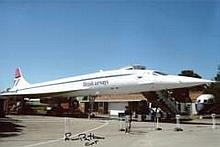 Concorde Pilot: 8x12 inch photo, a view of Concorde standing at rest, signe