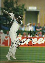 Sir Clive Lloyd signed superb 12 x 8 colour cricket action batting photo. Good condition
