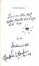 Muhammad Ali and Howard Bingham signed The Life of