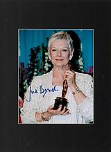 Dame Judi Dench autographed presentation piece. Mounted colour 8x10 photogr