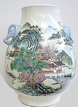 Vase en forme de jarre à décor de personnage, prises d'anses aux éléphants. Porte une marque.