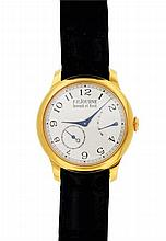 Montre-bracelet en or signée sur la lunette arrière 'Chronomètre Souverain
