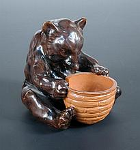 A Royal Doulton stoneware figure of a brown bear,