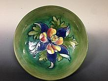 A Moorcroft Columbine pattern footed bowl,