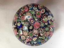 A Clichy scrambled millefiori paperweight,