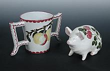 A Wemyss Ware loving cup and a Plichta pig,