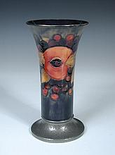 A Moorcroft pomegranate pattern trumpet vase with Tudric pewter foot,