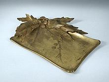After Leon Kann, an Art Nouveau gilt and patinated bronze tray,