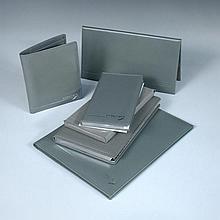 A collection of grey calf leather Concorde memorabilia,