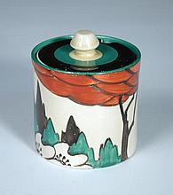A Clarice Cliff Limberlost pattern preserve jar and cover,