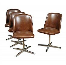 A set of four mid 20th century vinyl upholstered swivel dining chairs,