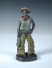 An Austrian cold painted bronze model of a cowboy,