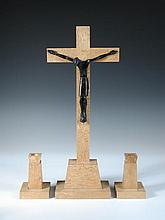 Jean Lambert-Rucki, a bronze and figured maple Crucifix and pair of candlesticks en suite,