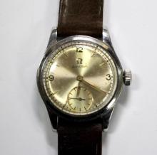 By Omega - a gentleman's mid-sized steel cased wrist watch,