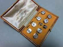 A complete diamond and mother-of-pearl dress set cased by Collingwood,