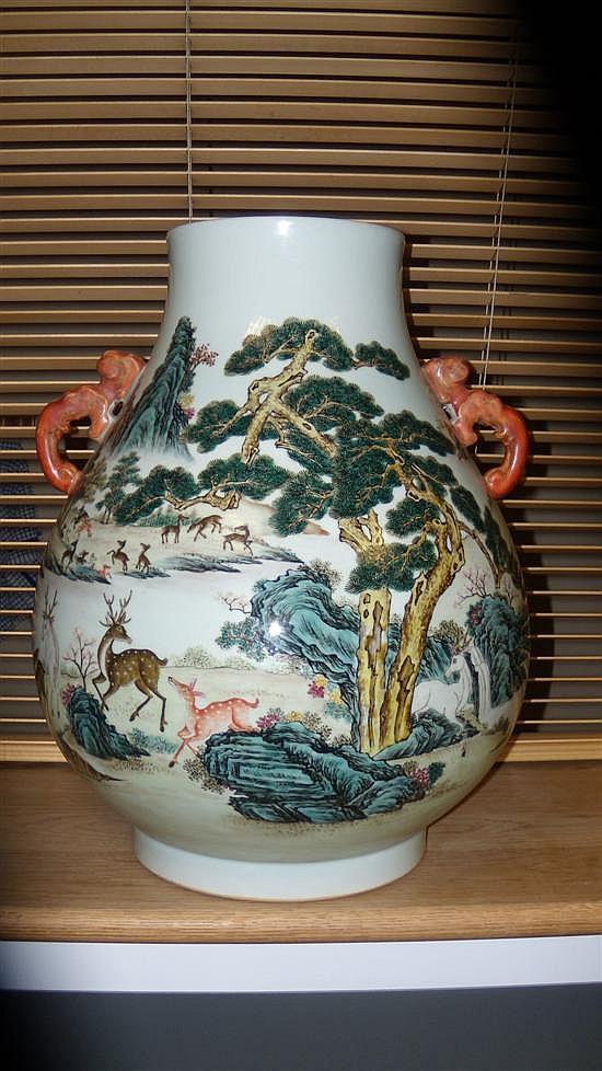A Qianlong style famille rose vase,