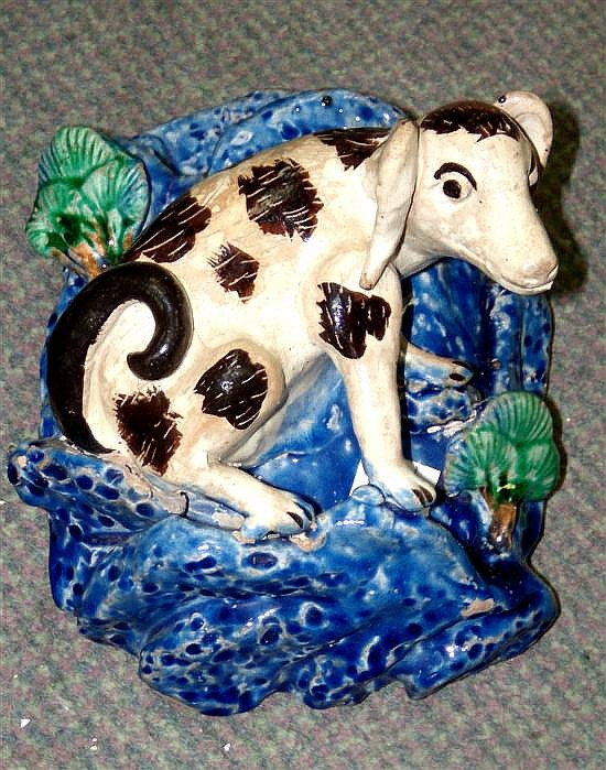 A 19th century pottery canine wall bracket,