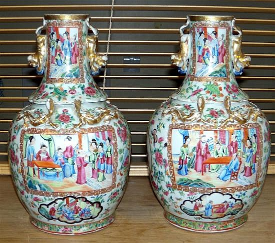A pair of 19th century Canton vases,