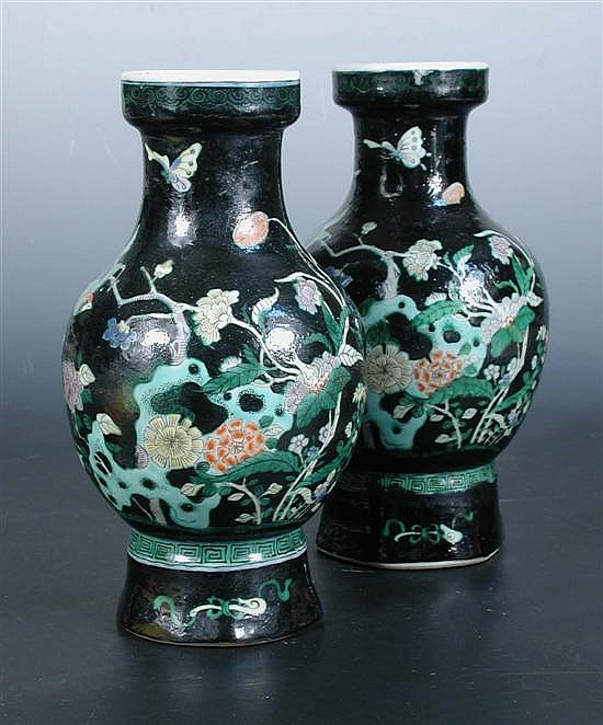 A pair of Kangxi style famille noire vases,