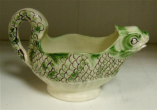 A mid 18th century creamware sea fish sauce boat,