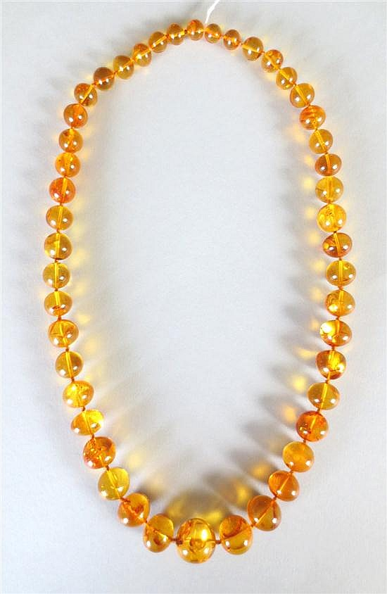 An amber necklace of graduated beads,