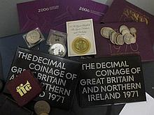 A selection of British coins including some late 19th/early 20th century silver coins, commemorative & other coins & crowns
