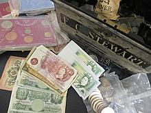 A strong box containing a small collection of modern British commemorative coins, crowns and other modern coinage, including banknotes