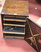 A late 19th century oak coin cabinet,
