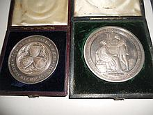 Four cased medallions: