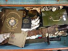A leather suitcase containing various items of militaria,
