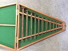 An unusual cased set of twelve graduated Roman nails,