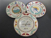 Three French pottery plates, each painted commemorating the Army, Navy and Air Force 1914-1915, marked to reverse 'grandes magasins...