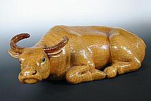 A 19th century Chinese ochre glazed water buffalo,