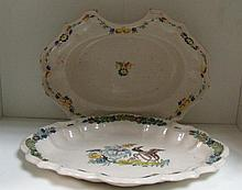 An 18th century French faience barber's bowl and a dish, possibly Strasbourg,